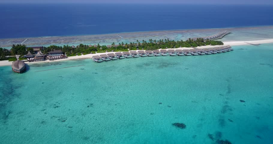 Aerial flying drone view of Maldives white sandy beach on sunny tropical paradise island with aqua blue sky sea water ocean 4k | Shutterstock HD Video #28216114