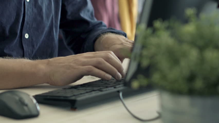 Young man working on pc computer sitting by table at home  | Shutterstock HD Video #28221622