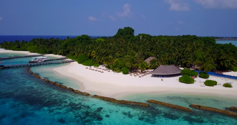 Aerial flying drone view of Maldives white sandy beach on sunny tropical paradise island with aqua blue sky sea water ocean 4k | Shutterstock HD Video #28253281
