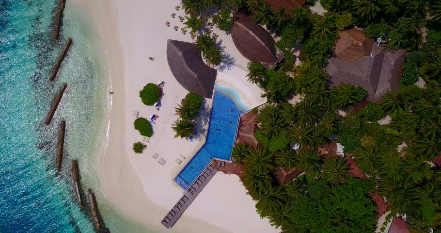 v06687 Aerial flying drone view of Maldives white sandy beach swimming pool in luxury 5 star resort hotel relaxing holiday vacation on sunny tropical paradise island with aqua blue sky sea ocean 4k #28266271