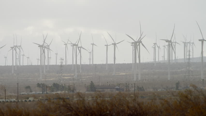 The shooting of functioning windmills in the countryside #28271095