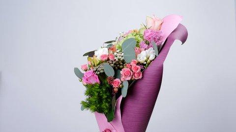 Flowers, bouquet, rotation, floral composition consists of Rose aqua, Ornithogalum, Brunia green, eucalyptus, Cymbidium orchid, Protea, Barbatus,Cymbidium orchid, Protea, Barbatus,
