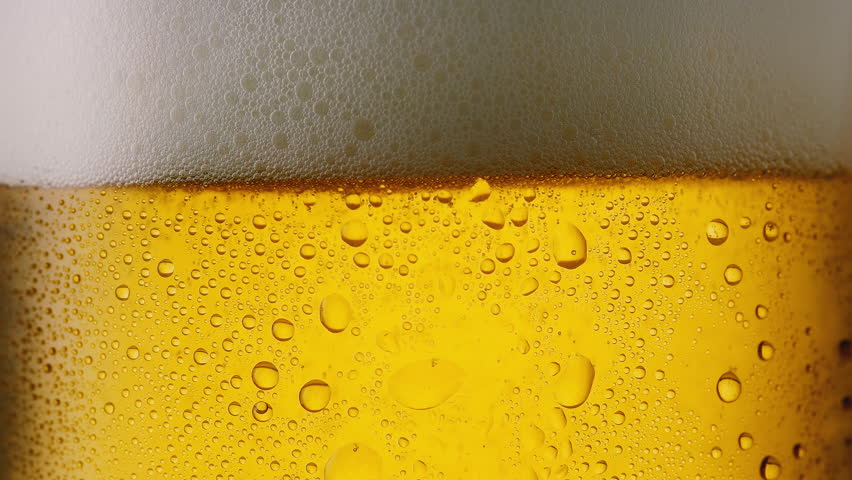 Cool fresh beer with condensation drops, 4k | Shutterstock HD Video #28290007