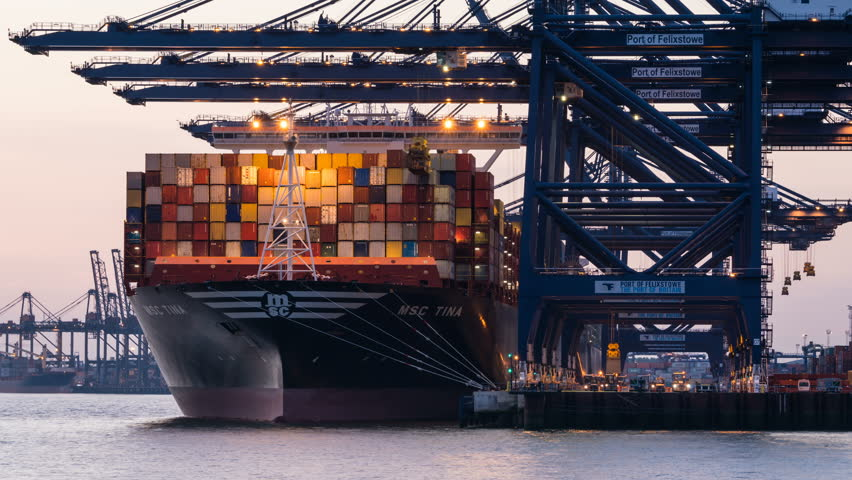 PORT OF FELIXSTOWE UK - CIRCA 2017: timelapse unloading containers of cargo ship
