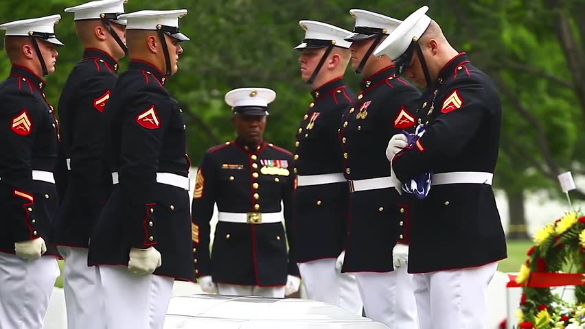 2010s: U.S. Marine honor guard leads a funeral for a fallen soldier.