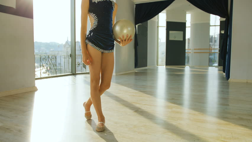 Portrait of cute gymnast doing circle with ball on the neck in the ballet studio. | Shutterstock HD Video #28316860