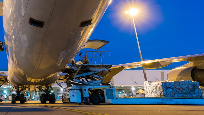 Business of air cargo freighter with import and export at twilight sky - Time lapse panning