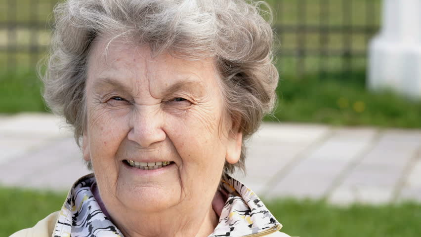 Portrait of smiling mature old woman aged 80s outdoors. Slow Motion #28331923