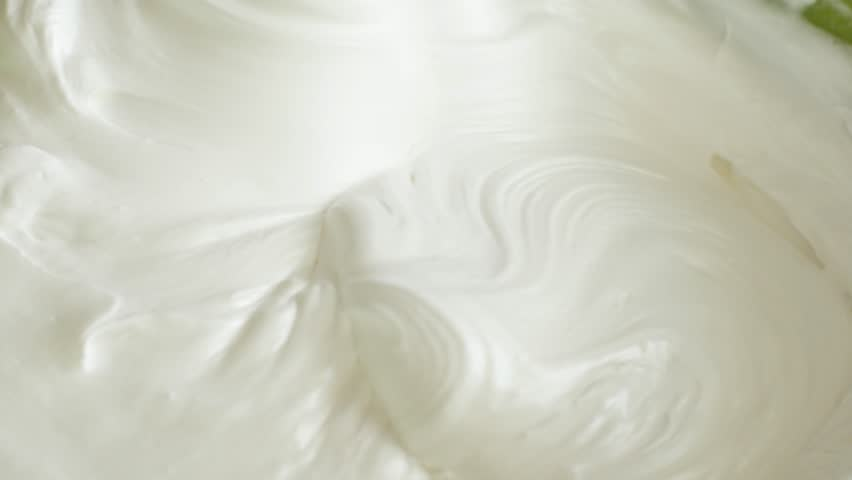 Kitchen mixer whips cream custard pastry whisk rotates rapidly. Food processor beat the eggs white egg whites into a thick foam. Kitchen machine in operation.   Shutterstock HD Video #28349155