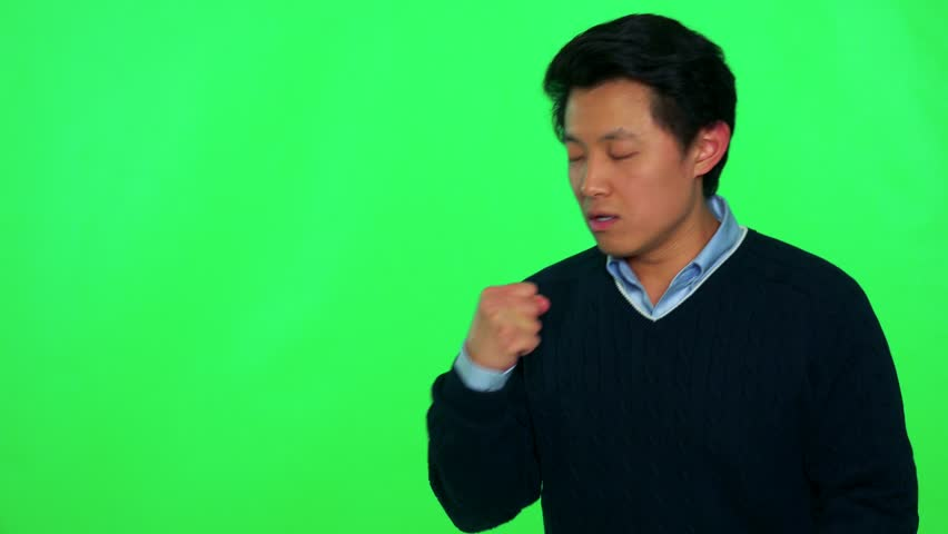 A young Asian man celebrates with relief - green screen studio | Shutterstock HD Video #28361602