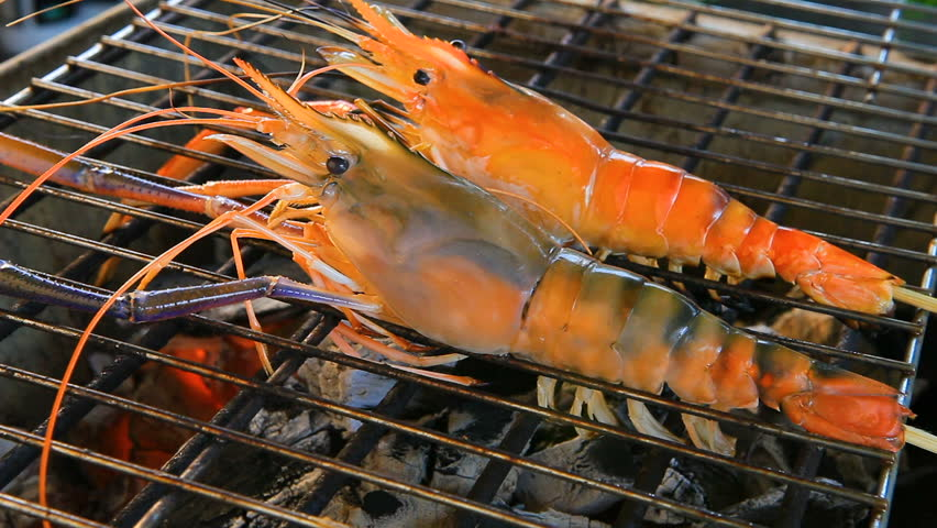 Shrimp grilled on barbeque chaocoal oven  | Shutterstock HD Video #28364671