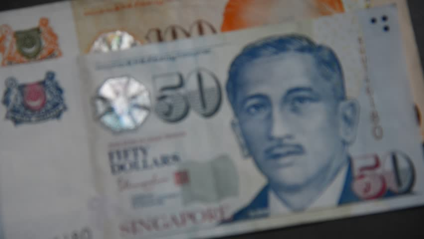 Portrait in Singapore banknotes (50-100 SGD) - currency concept - close up. | Shutterstock HD Video #28376218