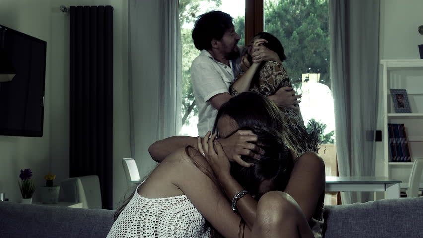 Teenage daughters crying while father hits mother at home desaturated | Shutterstock HD Video #28379608
