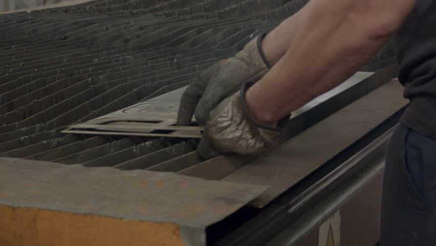 Man making metal letters   Shutterstock HD Video #28397821