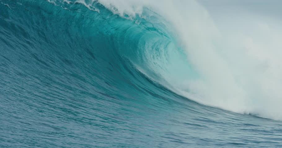 Giant Blue Ocean Wave Breaking in Slow Motion