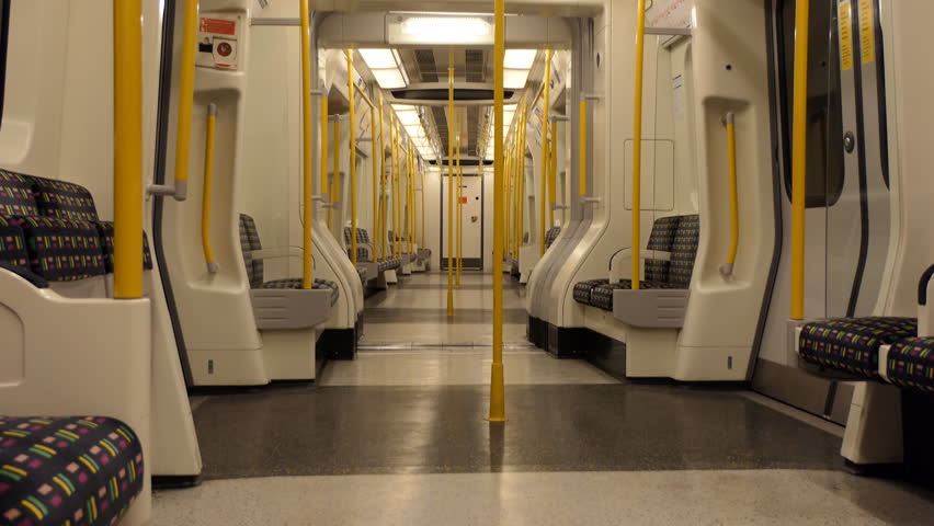Empty city subway underground tube train carriage swinging sideways and arriving at a station