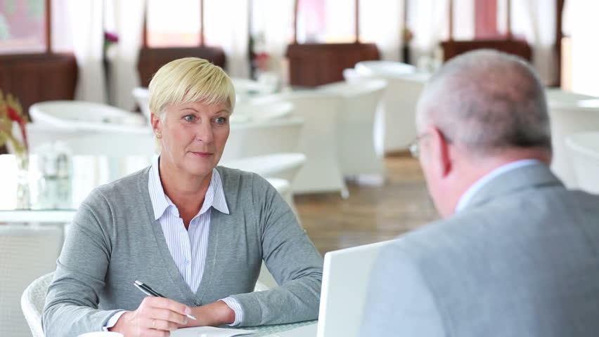 Mature businesswoman listening attentively to an applicant for a vacant position