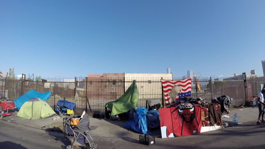 Los Angeles, California, USA - July 4, 2017:  Homeless tents along gritty downtown Skid Row streets.