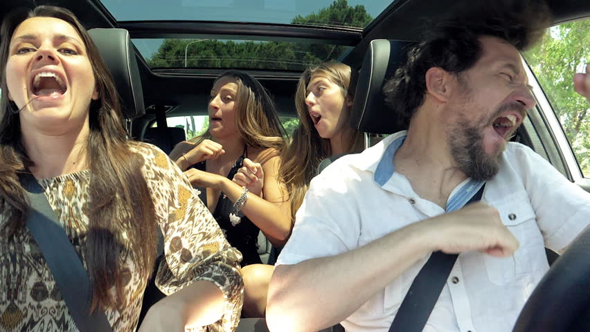 Teenager girls giving high five to mother and father in car dancing #28451491
