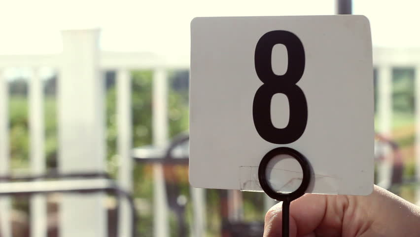 A number eight tabletop sign is placed on table in restaurant | Shutterstock HD Video #28461574