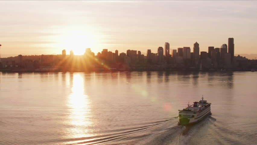 Seattle, Washington circa-2017, Ferry heading towards Seattle at sunrise. Shot with Cineflex and RED Epic-W Helium.