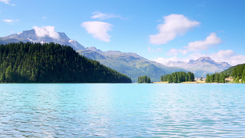 Impressive scene of azure pond Champfer in alpine valley. Popular tourist attraction. Picturesque day. Location Swiss alps, Silvaplana village, district of Maloja, Europe. Explore the world's beauty.   Shutterstock HD Video #28488196