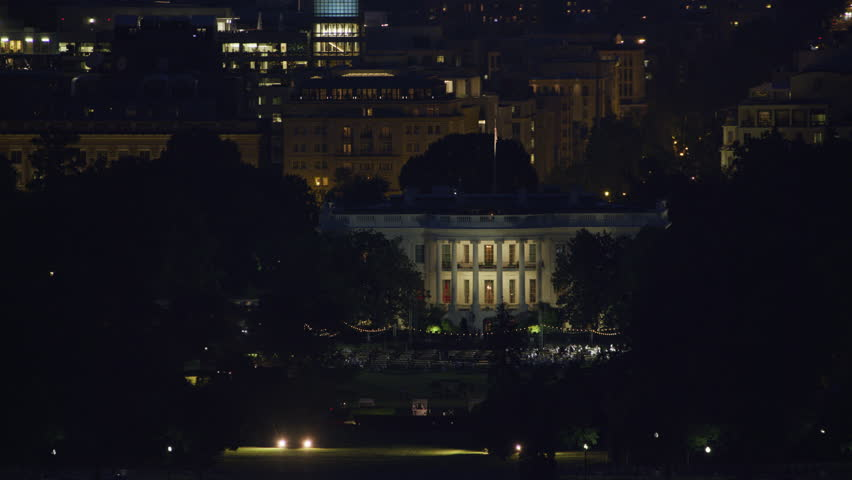 Washington, D.C. circa-2017, Aerial view as Washington Monument passes by White House at night. Shot with Cineflex and RED Epic-W Helium. | Shutterstock HD Video #28498846