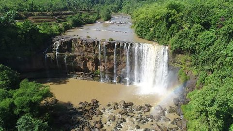Magnificent rainbow at the waterfall in West Java, Indonesia.