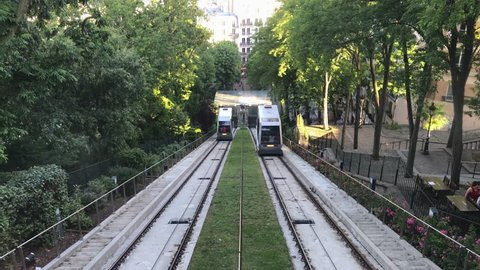PARIS, FRANCE, JUNE 06 2017: Funicular to the famous Basilica of Sacre Coeur, dedicated to Sacred Heart of Jesus - a very popular place in Montmartre.