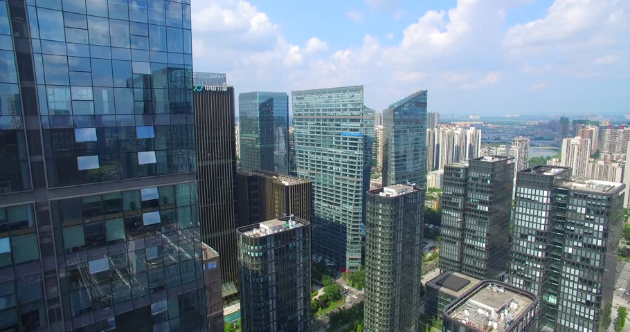 aerial view of drone flying over beautiful new modern Chengdu City with many high office buildings #28518466