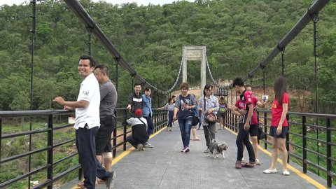 CHIANGMAI THAILAND JULY 2:Unidentified people go for a walk  and scenic view on longest suspension bridge in Chiangmai Province on July 2,2017 Chiangmai Thailand.