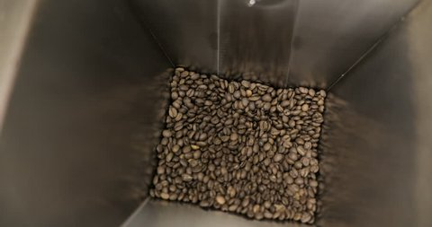 Roasting Coffee Beans Whirling Mixed On Cooling Unit Platform In A Manufactory Workshop