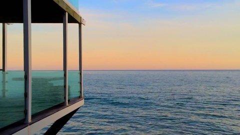 Modern building at Zuma Beach in Malibu at sunset, California, USA