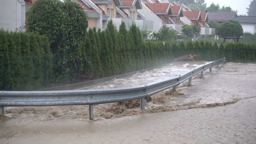 Slovenska Bistrica, Slovenia - July 7 2017: Floods hit the town Slovenska Bistrica in Slovenia after heavy rain. Several houses and shops were flooded while emergency services and firefighters rush in