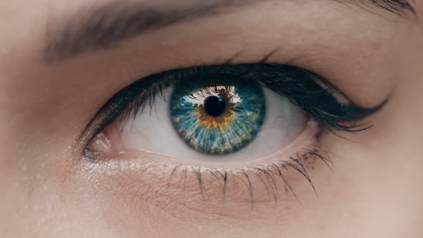 Young Woman is opening and closing her beautiful eye. Macro Close-up eye blinking.