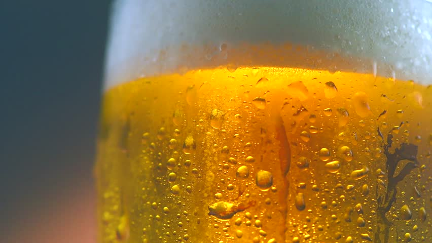 Cold Light Beer in a glass with water drops. Craft Beer close up. Rotation 360 degrees. 4K UHD video 3840x2160 #28569739