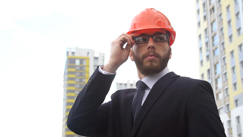 Portrait of male architect . Young people at construction site. Slow motion #28591099
