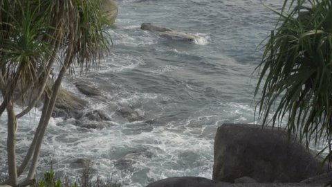 Turquoise waves rolled on the rocks, beach of Koh Miang island, Similan Islands, slow motion