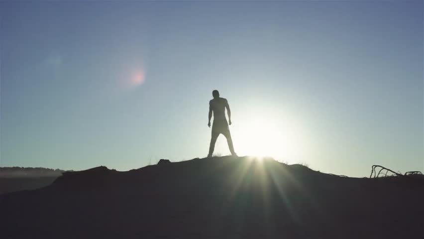 Man`s Silhouette at sunrise | Shutterstock HD Video #28602316