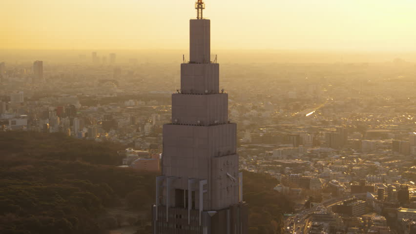 Japan Tokyo Aerial v10 Flying around NTT Docomo clock tower with cityscape views sunset 2/17 | Shutterstock HD Video #28603609