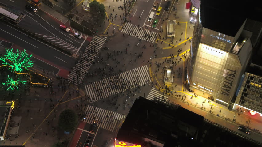 Japan Tokyo Aerial v20 Vertical birdseye view flying low over famous Shibuya intersection crossing night 2/17