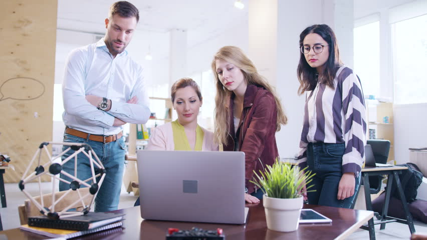 Young Creative Team Staring At A Laptop Screen Alarmed And Worried Scarred Camera Push Comical Funny Angle Stocks Plummeting Bad News Company Bankruptcy Concept | Shutterstock HD Video #28616350