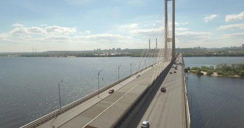 Aerial of the south bridge, city Kyiv Ukraine. South Bridge city of Kiev. The river of the Dnieper, the bridge crosses the river. City landscape from a bird's eye view bridge on river. summer day