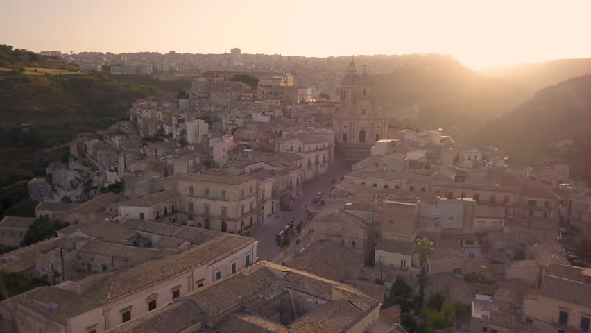Flying clockwise over Ragusa Ibla piazza at sunset