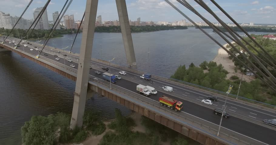 City landscape, Moscow bridge, Kiev. Aerial photography of a bridge in a summer sunny day.  Bridge over the Dnieper River from a bird's eye view. The Dnieper River against the backdrop.  | Shutterstock HD Video #28622101