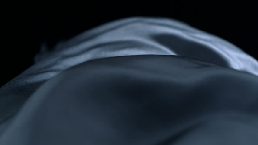 Grey silk fabric blowing in the wind shooting with high speed camera.