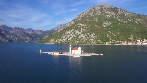 Boka Bay, Montenegro-2010s: Beautiful aerial over the Our Lady rock island church in Boka Bay, Montenegro.