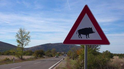 Croatia-2010s: A road sign warns of wild boars along the highway in Croatia.