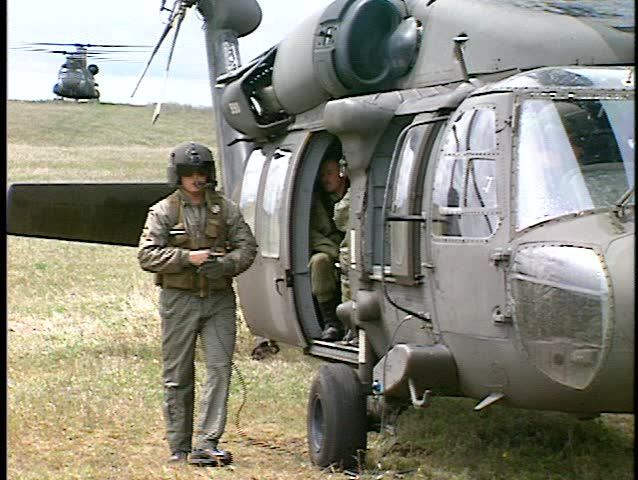 UH60 Blackhawk helicopter, ready to fly, crew preparation,  CH47 helicopter idling in background (BetacamSP, good audio)