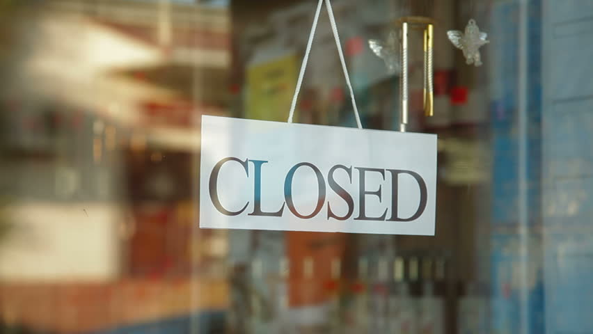 Business owner turns sign from closed to open in front of her store | Shutterstock HD Video #2867836